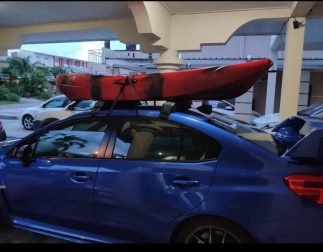 Kayak with Roof Rack, Roof Top and Wind Sail